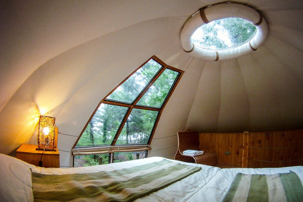 Bedroom in a dome bungalow at Magma Lodge, Pucon