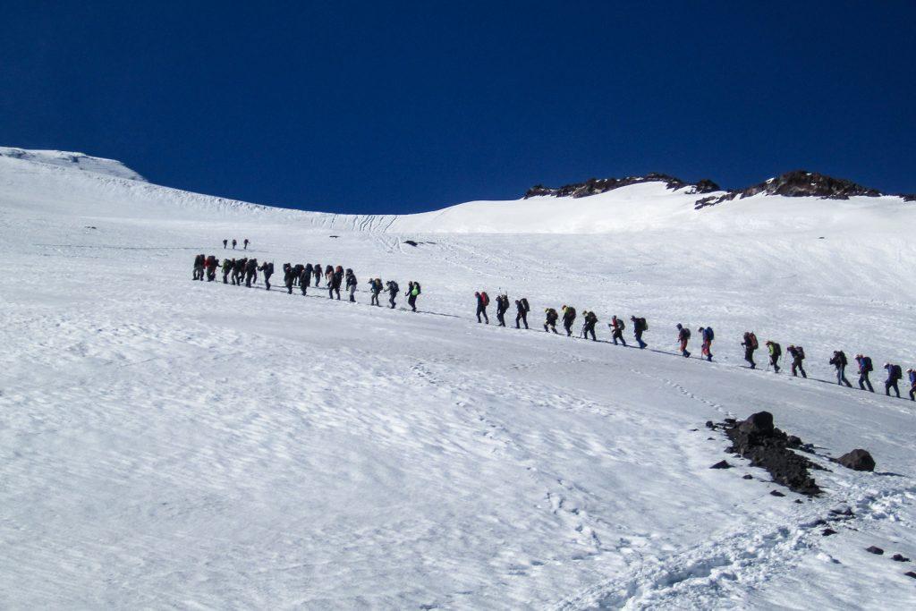A line of climbers ascending Volcan Villarrica