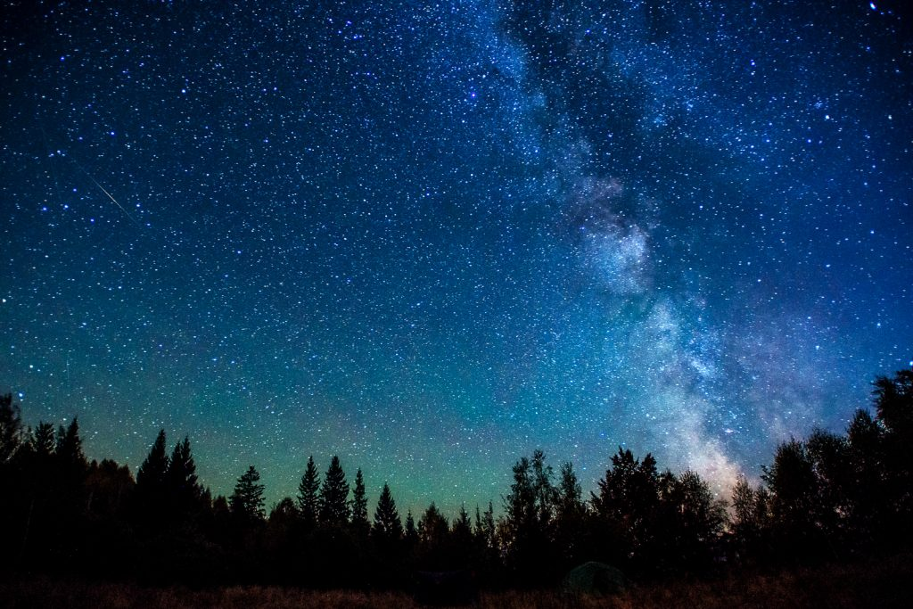 Stargazing in a dark sky away from light pollution and urban areas. Best dark sky viewed when the moon is set. Sky view of the Milkyway galaxy.