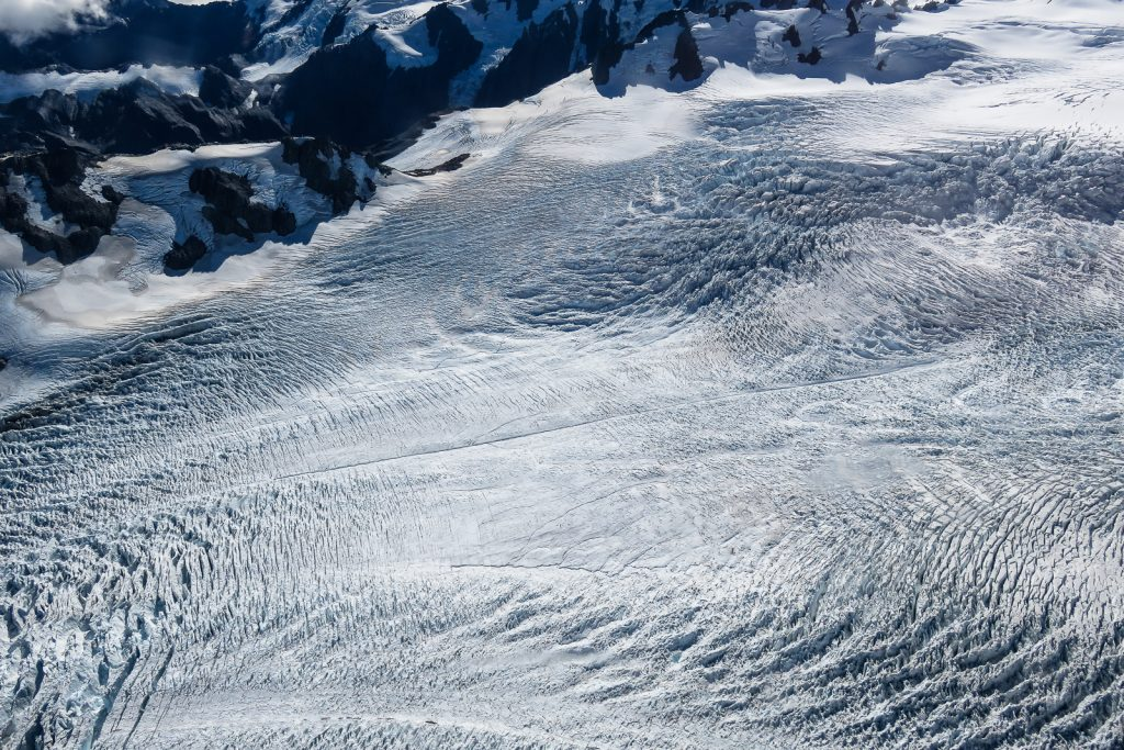 Glacier Crevasses on Fox Glacier in South Island New Zealand, flight seeing helicopter, south island itinerary