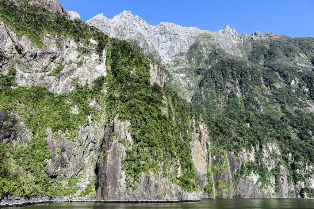 Milford Sound boat cruise along the cliffs. milford sound cruise from te anau