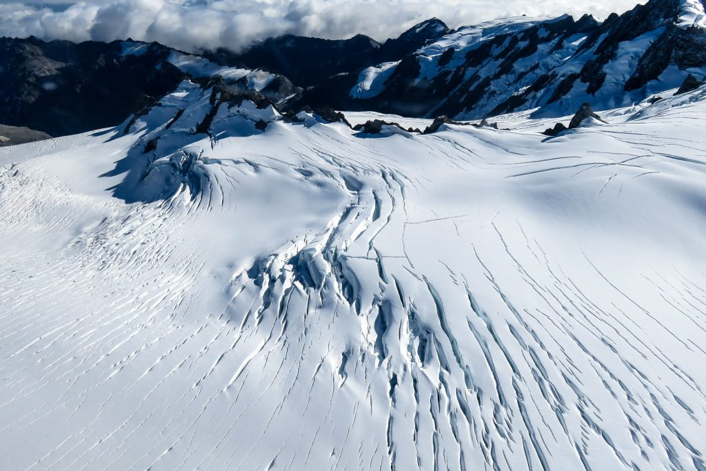 Fox Glacier crevasses seen from helicopter over flight. Fox glacier ice sheet joins with Franz Josef Glacier