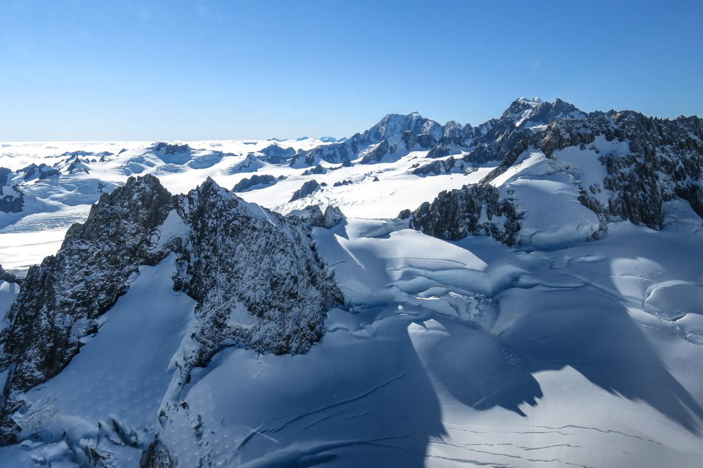 The ice sheet and mounts joining Fox Glacier and Franz Josef Glacier, South Island tour by helicopter flight