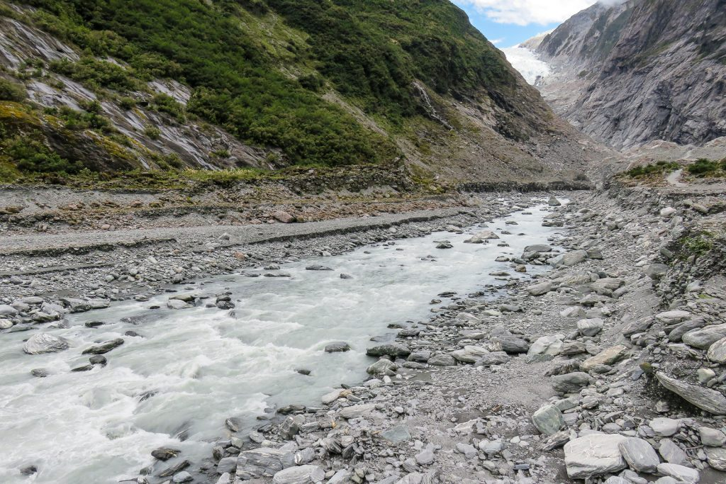 The walk to the Terminal Face of Franz Josef Glacier along the glacier melt water Waiho River