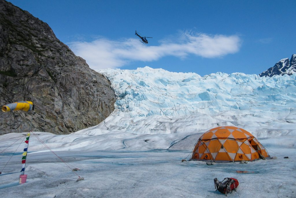 Helicopter Landing on Mendenhall Glacier on Juneau Icefield in Alaska for glacier trekking